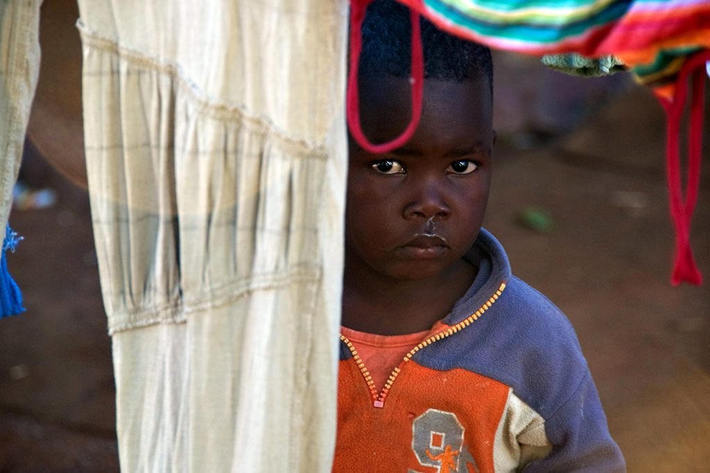 Shy child in soweto shanty town