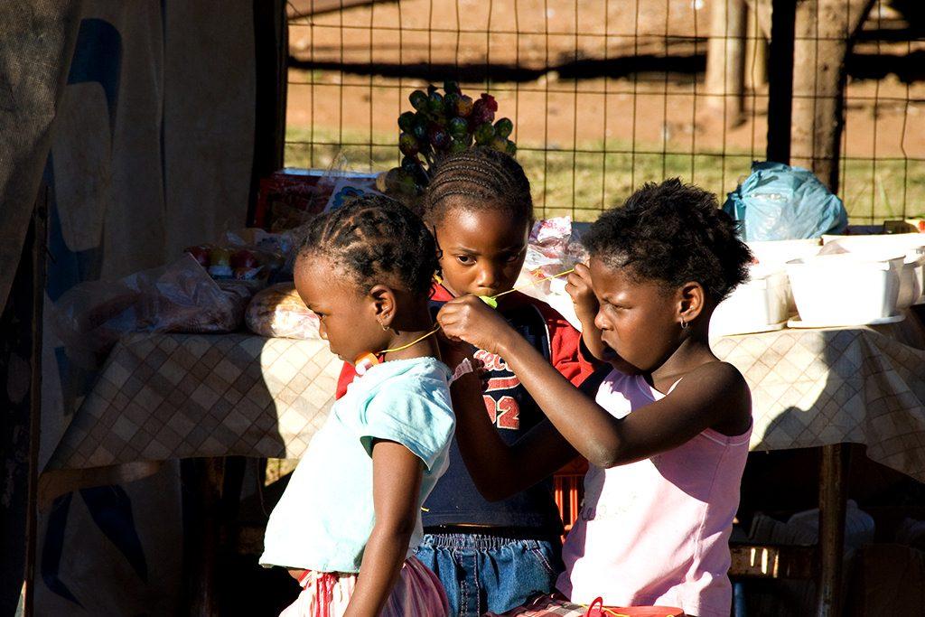 Girls playing dress-ups. Soweto